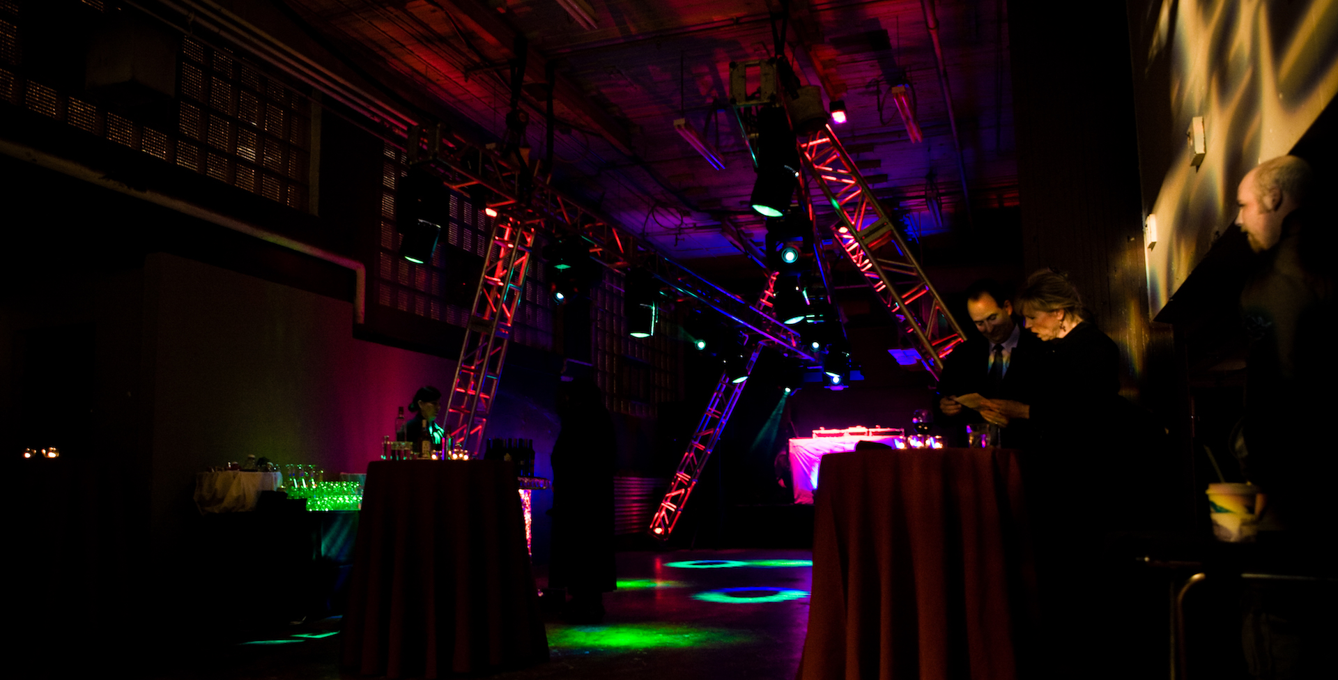 Truss sticks at odd angles and breakup gobos create a mysterious and exciting atmposphere for a corporate party