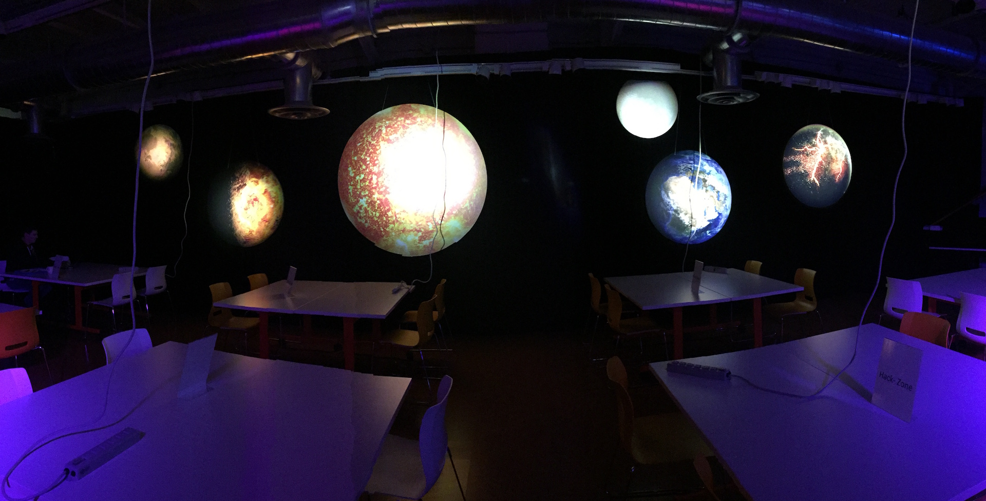Thick, quality custom signs create a planetary solar system for a space themed hackathon
